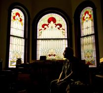 Robert LaCount, a recovering addict who voted for Donald Trump, sits for a photo in the old church he is fixing up as a community center in Hoquiam, Washington, June 12, 2017. (AP Photo/David Goldman)