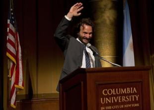 AP photographer Rodrigo Abd waves during the award ceremony of the Maria Moors Cabot Prize at Columbia University in New York, Oct. 18, 2016. (AP Photo/Enric Marti)