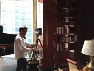 """Interactive editor Nathan Griffiths setting up the Matterport 3-D camera used to shoot the penthouse suite at the Four Seasons in New York, one of the locations featured in the """"The Suite Life,"""" AP's first virtual reality project."""
