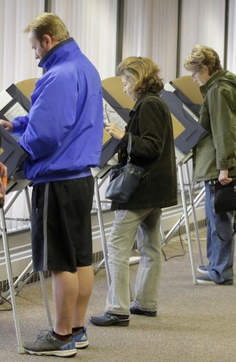Voters cast ballots during early voting at the Salt Lake County Government Center in Salt Lake City, Nov. 1, 2016. (AP Photo/Rick Bowmer)