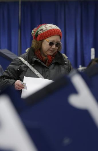 Chicago resident Sonja Russell casts her ballot in Illinois primary elections at the city's new early voting super site in downtown Chicago, March 13, 2018. (AP Photo/Kiichiro Sato)