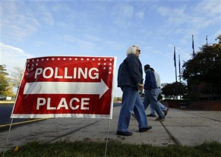Voters arrive and depart during early voting at a polling place at the Wicomico County Youth and Civic Center in Salisbury, Md., Oct. 31, 2012. (AP Photo/Alex Brandon)