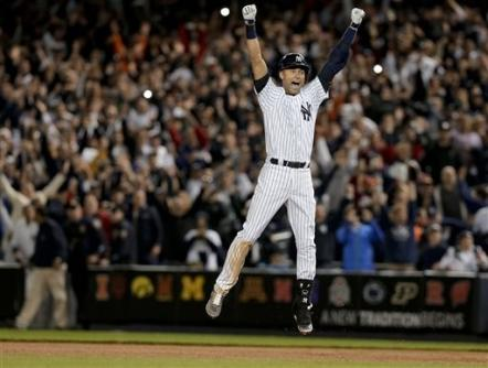 In this Sept. 25, 2014, file photo, New York Yankees' Derek Jeter jumps after hitting the game-winning RBI single against the Baltimore Orioles in the ninth inning of a baseball game in New York. The Yankees won 6-5. (AP Photo/Julie Jacobson)