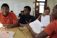 Jamain Lee, center, looks at classmate Andre'veon Mosby at Milwaukee Math and Science Academy, a charter school in Milwaukee, Oct. 20, 2017. (AP Photo/Carrie Antlfinger)
