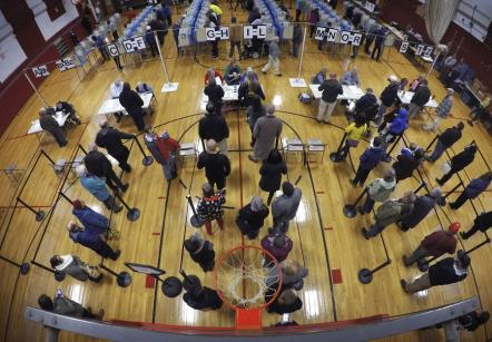 Voters wait in line in the gymnasium of Brunswick Junior High School in Brunswick, Maine, to receive ballots to vote in the midterm election, Nov. 2, 2018. (AP Photo/Robert F. Bukaty)