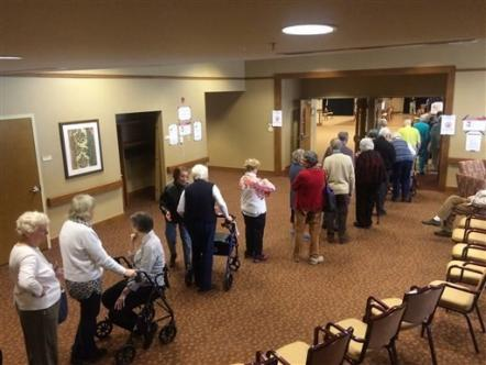 Residents of the Greenspring retirement community in Springfield line up to vote in Virginia's presidential primary, Tuesday, March 1, 2016. (AP Photo/Matthew Barakat)