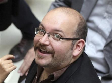 FILE - In this photo April 11, 2013 file photo, Jason Rezaian, an Iranian-American correspondent for the Washington Post, smiles as he attends a presidential campaign of President Hassan Rouhani in Tehran, Iran. (AP Photo/Vahid Salemi, File)