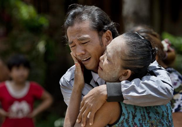 In this May 16, 2015 photo, former slave fisherman Myint Naing and his mother, Khin Than, cry as they are reunited after 22 years at their village in Mon State, Myanmar. (AP Photo/Gemunu Amarasinghe)