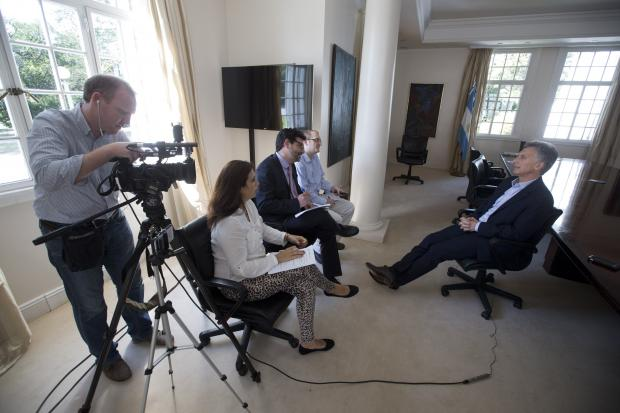 In this photo, from left to right are: television producer Paul Byrne, reporter Deborah Rey, Latin America News Director Paul Haven, Southern Cone News Editor Peter Prengaman, and Argentine President Mauricio Macri. (AP Photo / Victor Caivano)